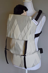 Olives and Applesauce Decadence Skyline is a grey and white large textured geometric print on the body panel, hood, and waistband, with light grey shoulder straps. This print is like an abstract argyle.