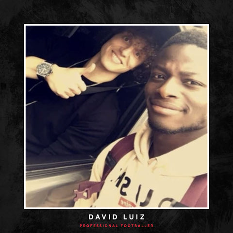 David Luiz posing with a DUSK Empire jumper.