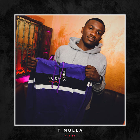 T Mulla posing with a DUSK Empire Royal Tracksuit.