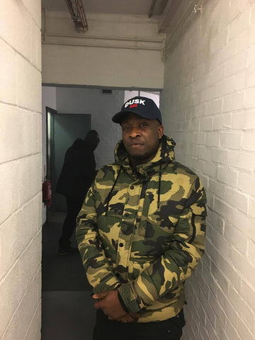 UK Rap & Afro-beats artist Kojo Funds pictured in his blue DUSK camp! Cambridge, March 2017.