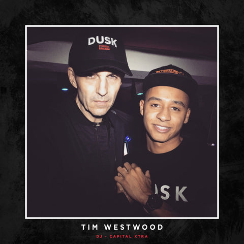 Tim Westwood posing with a DUSK Empire cap.