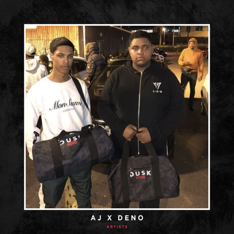 AJ & Deno posing with a DUSK Empire barrel bags.