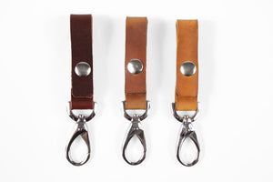 American, handmade leather keychain fobs with silver snaps in black, brown, wheat, natural and burgundy.