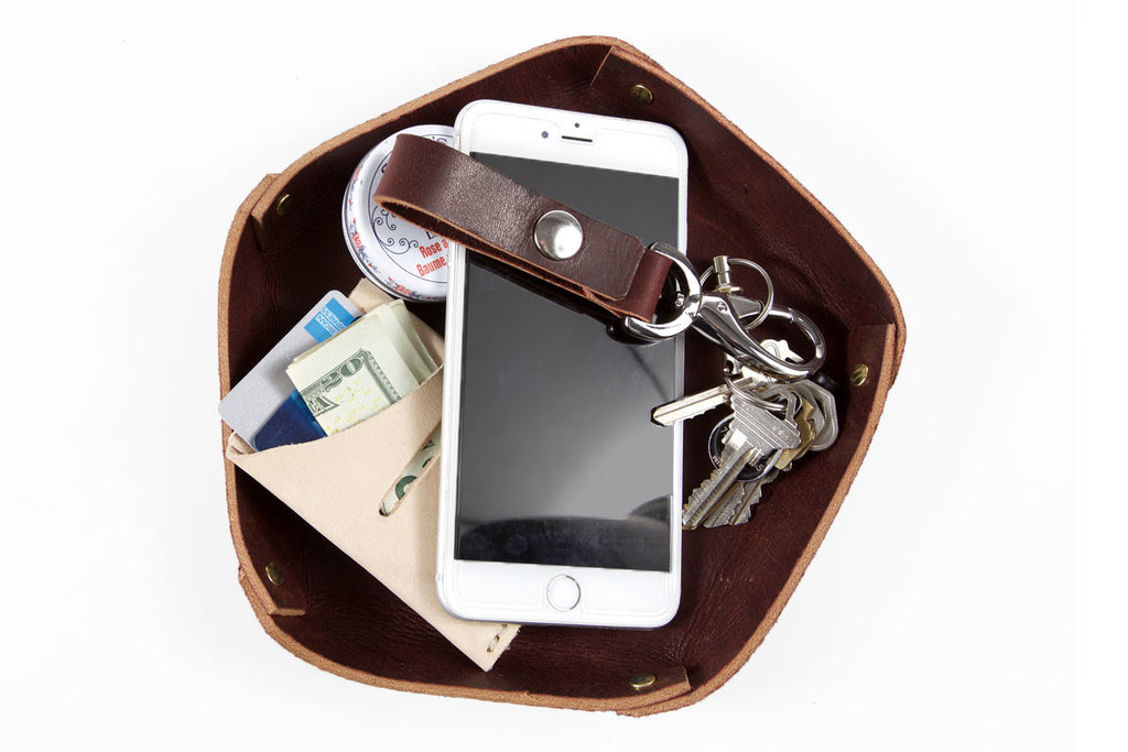 The Dapper a handmade, leather valet tray for keys, wallets, phones and other accessories.