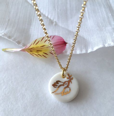 Gold Dove porcelain necklace .. Collier Colombe or en porcelaine