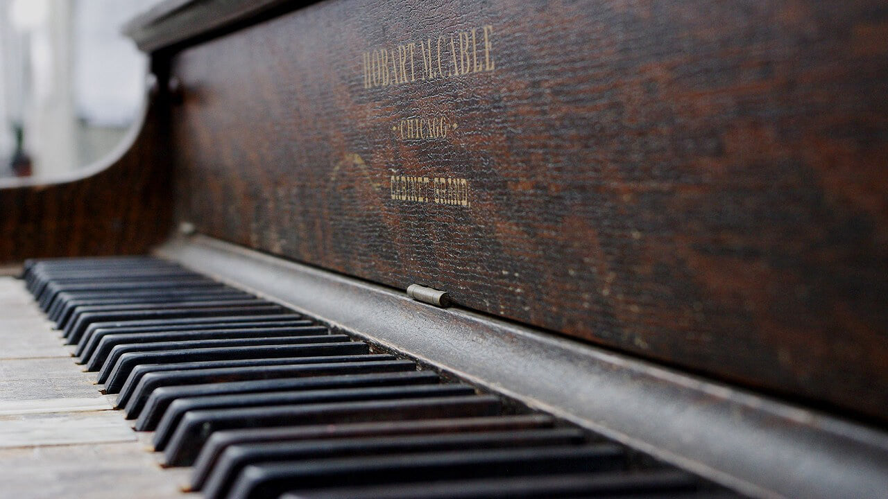 dust piano closeup without keyboard lid