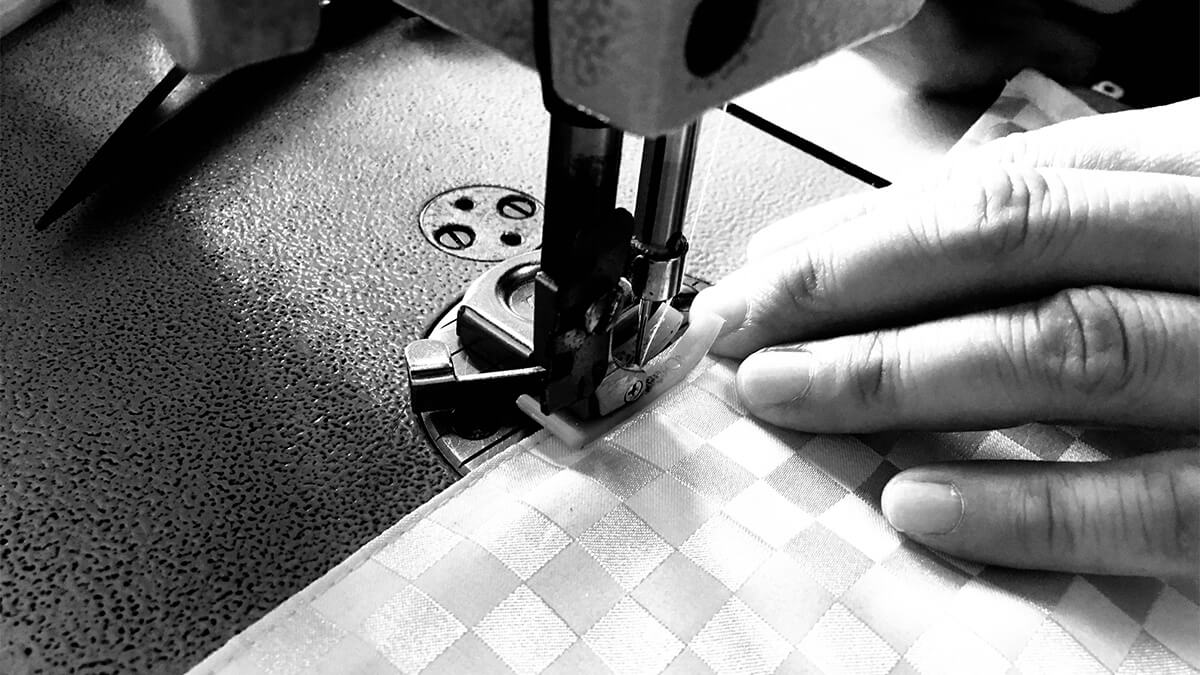 Tailor sewing a universal keyboard & digital piano cover
