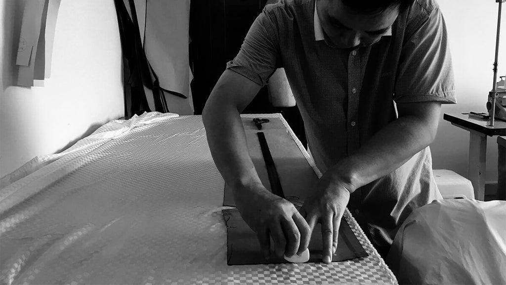 Full view of a Clairevoire tailor marking fabric for piano cover making