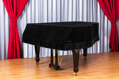 Black velvet grand piano cover full view in hall