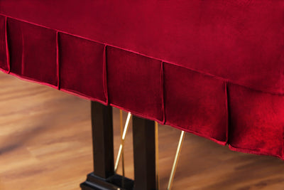 close up pleats detailing on grand piano cover