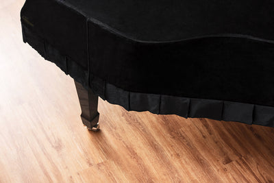contour of black grand piano cover in velvet top down view