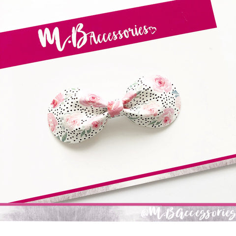 Polka dot rose print curved pinch bow