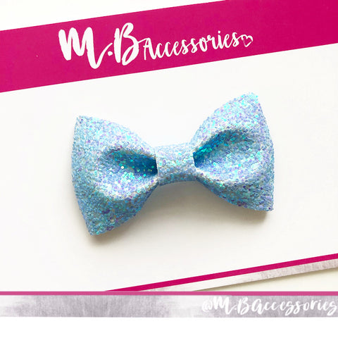 Iridescent purple/blue glitter pinch bow