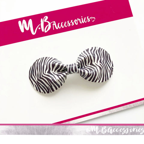 Zebra print curved pinch bow