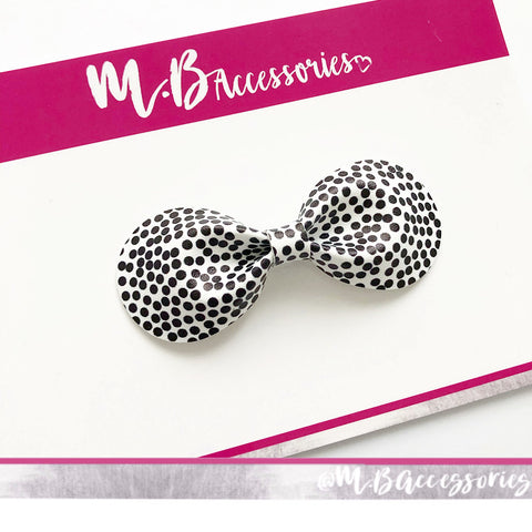 Polka dot curved pinch bow
