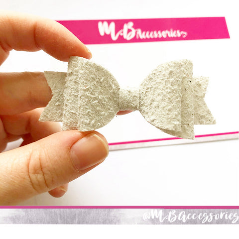 Pale grey wooly bow
