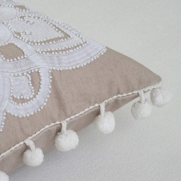 Tan and White Embroidered Cover