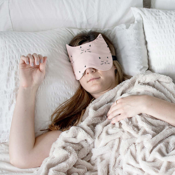 woman sleeping with cat sleep mask