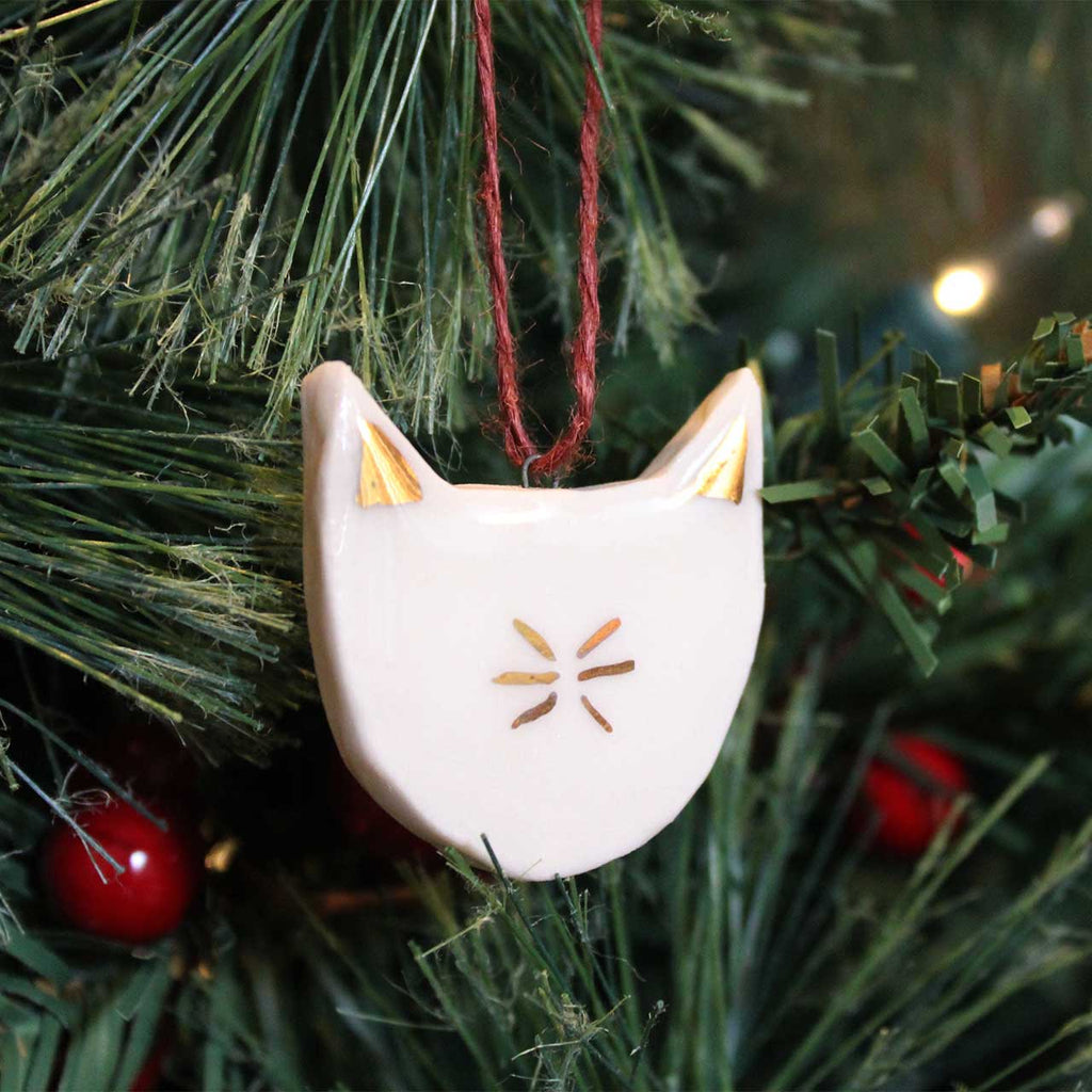 porcelain and gold cat ornament