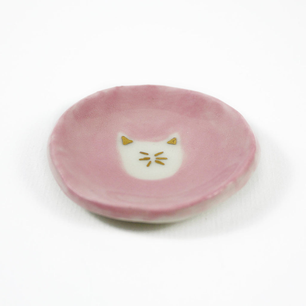 pink and gold cat dish
