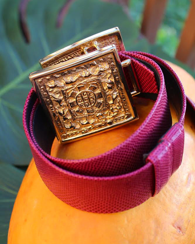 1980's Fuchsia Leather belt with large gold buckle embellishment