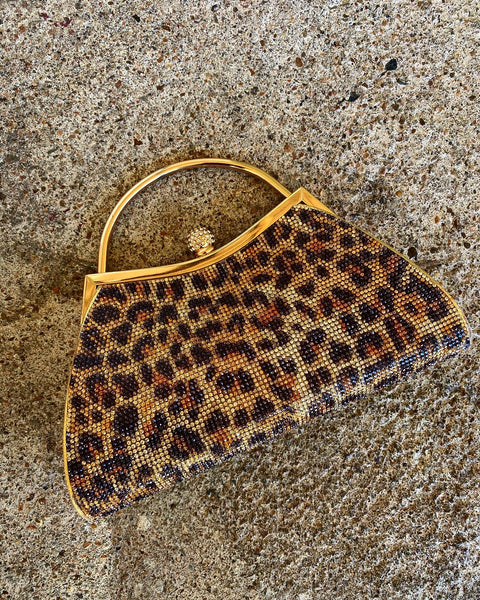 Evening leopard metal clutch