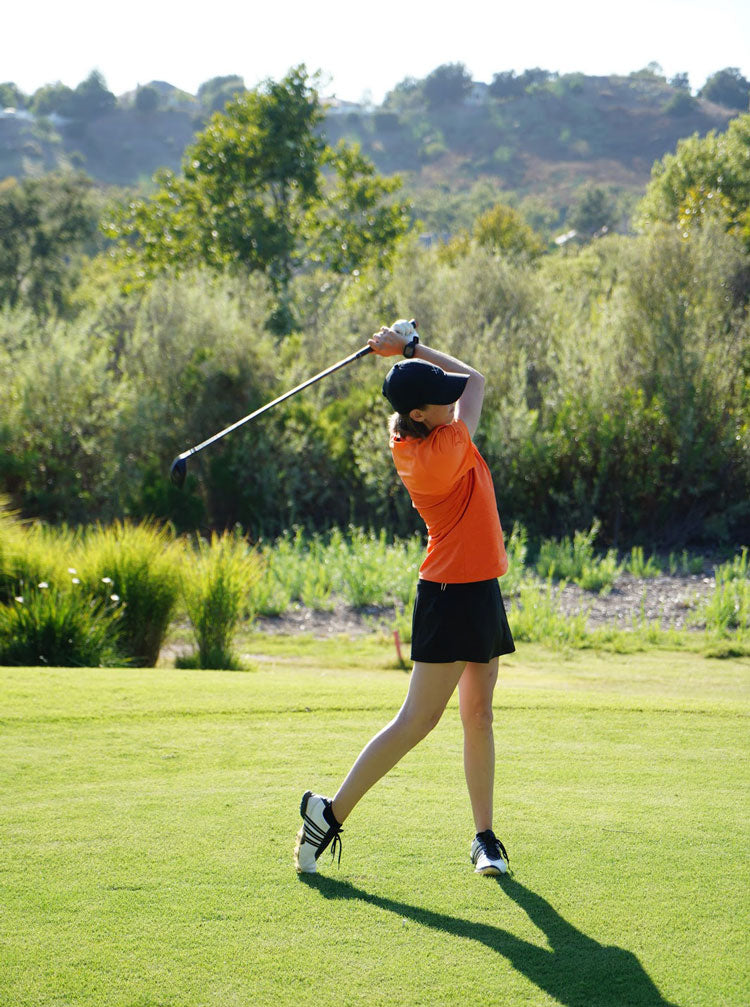 orange and black ladies' golf outfit