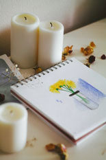 flower drawing on paper with candles