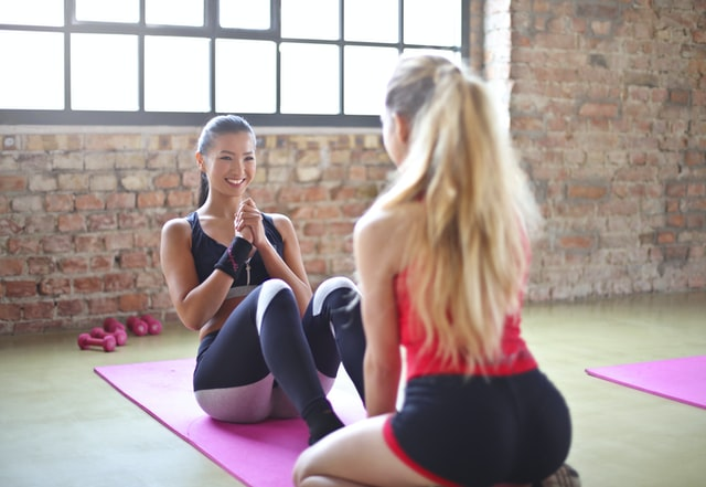 Two friends enjoying a workout together