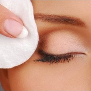 lady removing eye make up