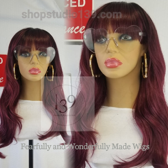 Lucy is a beautiful wavy Bang Wig