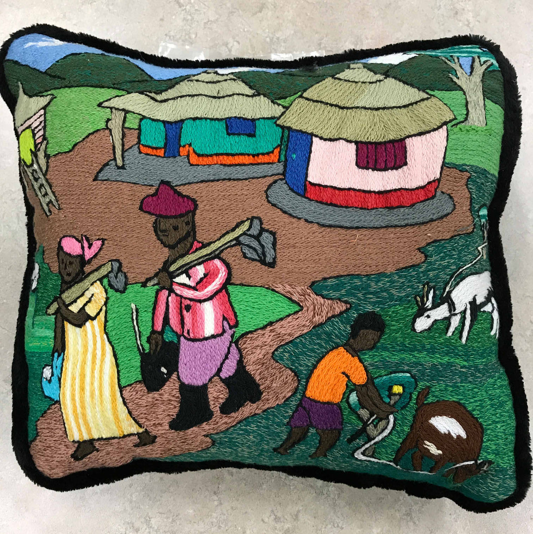 Pillow, mother and father with hoes going to the garden while boy tends the goats