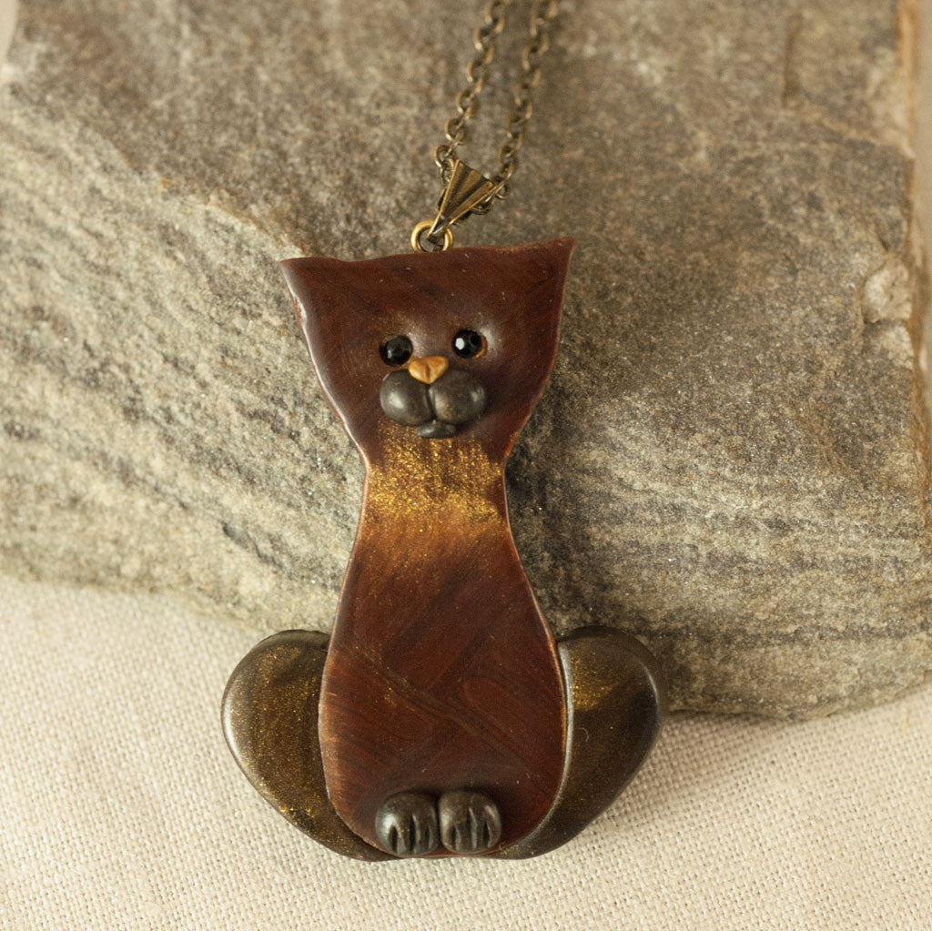 Whimsical Cat Pendant in Bronze and Gold Clay