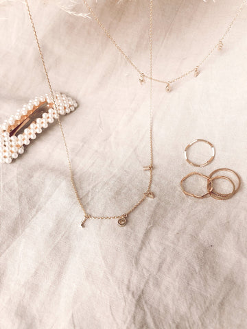 Dainty gold chain necklace spelling Love