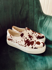 Kicking Up Slip Ons Cow Print