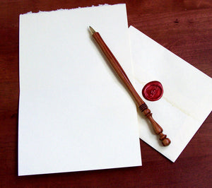 stationery with pen and sealed envelope