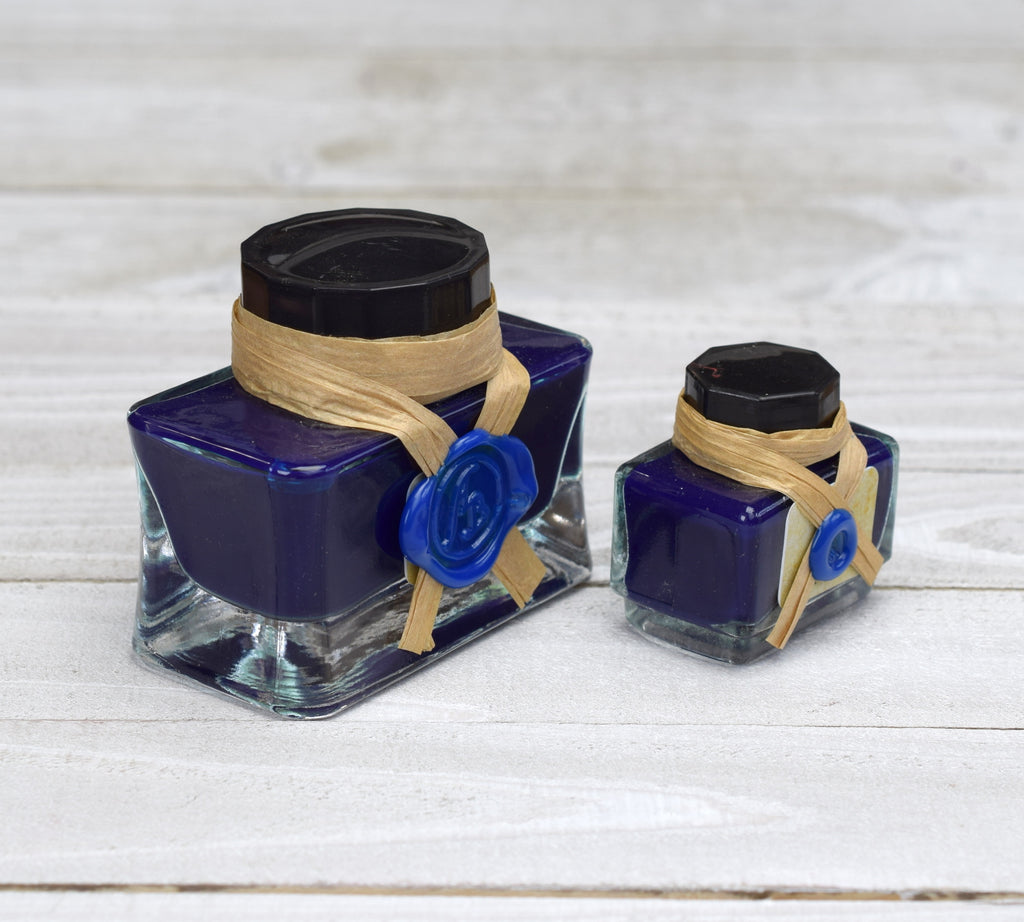 Blue ink bottles sealed with wax