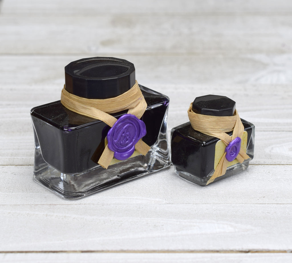 two sizes of purple writing ink