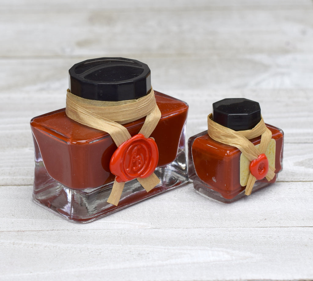 Glass bottles of red ink sealed in wax
