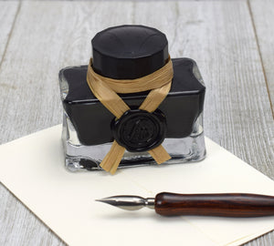 Black writing ink in keepsake glass bottle