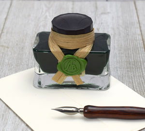 Green ink bottle and dip pen