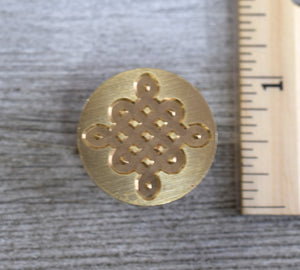 closeup of celtic knot brass seal