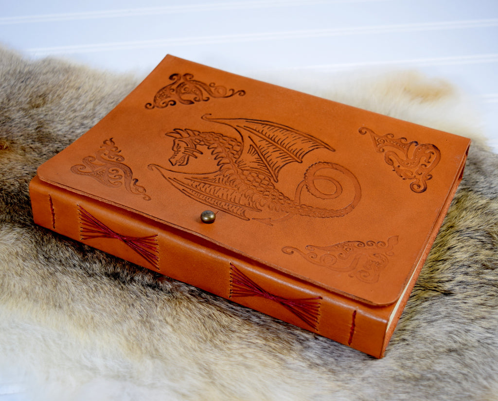 Leather journal with winged dragon design stamped on cover