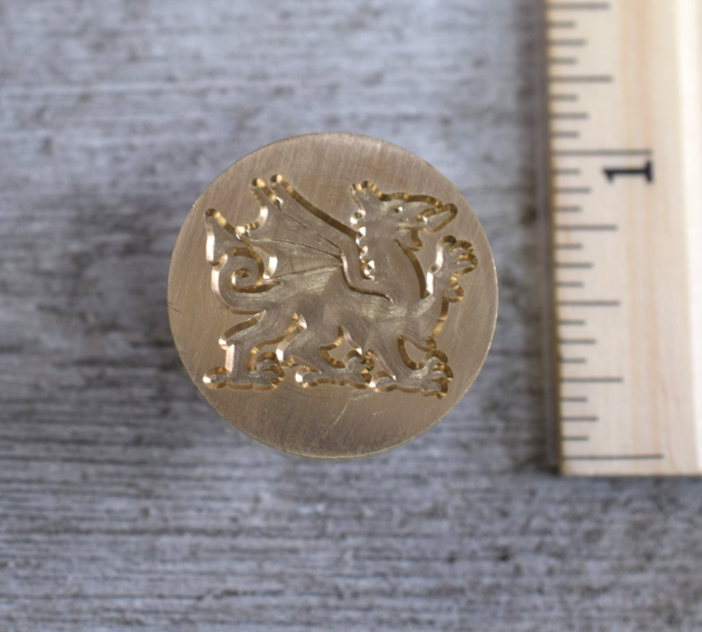 closeup of welsh dragon brass stamp head