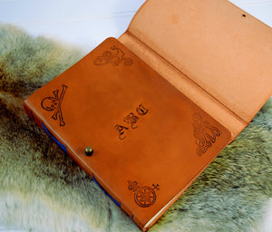 Inside cover of leather trifold journal with personalized name