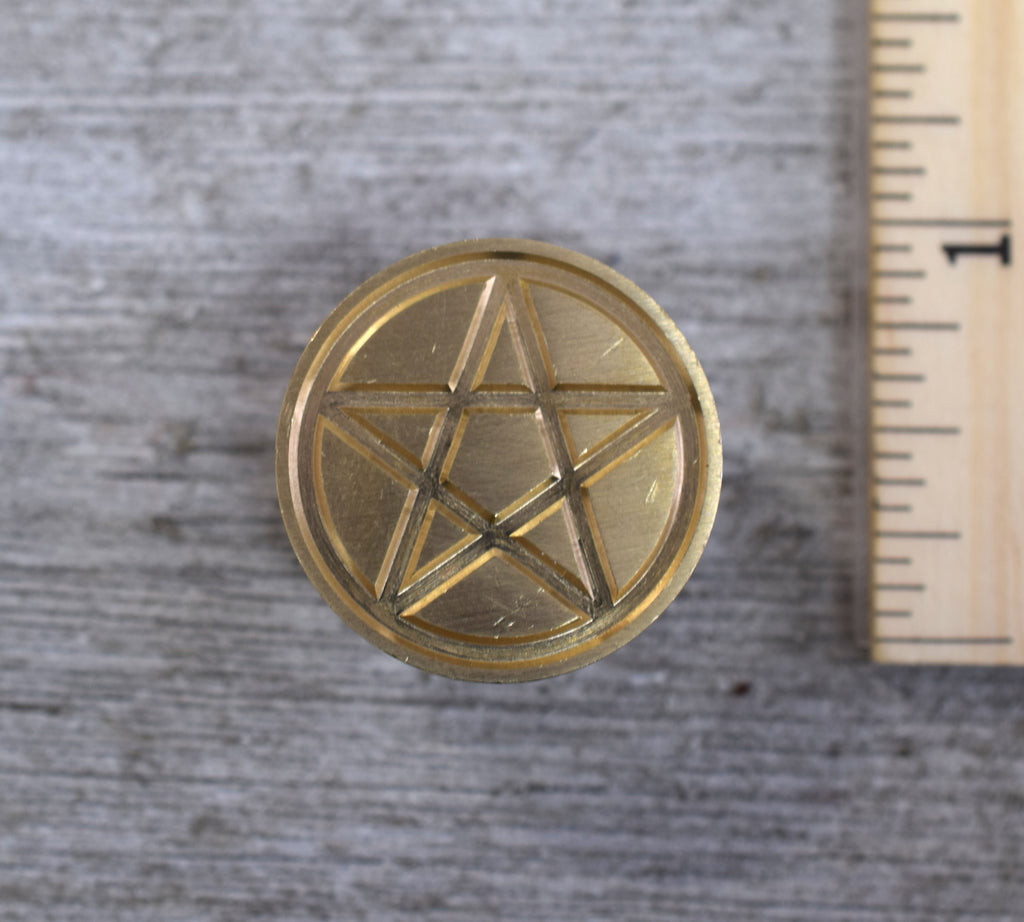 closeup of pentacle brass stamp head