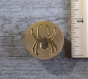 closeup of spider brass stamp head