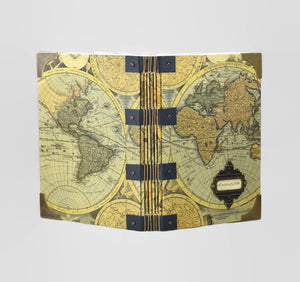open travel journal showing world map covers