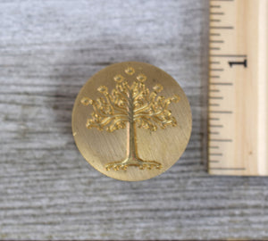 closeup of tree of gondor brass stamp head