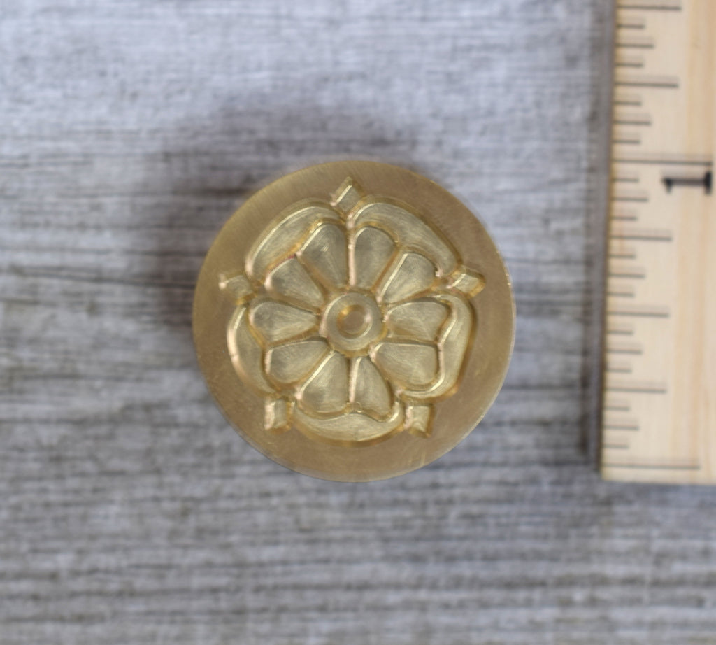 closeup of tudor rose brass stamp head